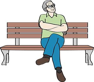 Mann sitzt auf einer Bank.