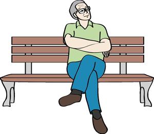 Mann sitzt auf einer Bank