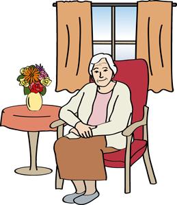 Seniorin sitzt im Sessel