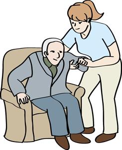 Eine Frau hilft einem älteren Mann, aus dem Sessel aufzustehen.