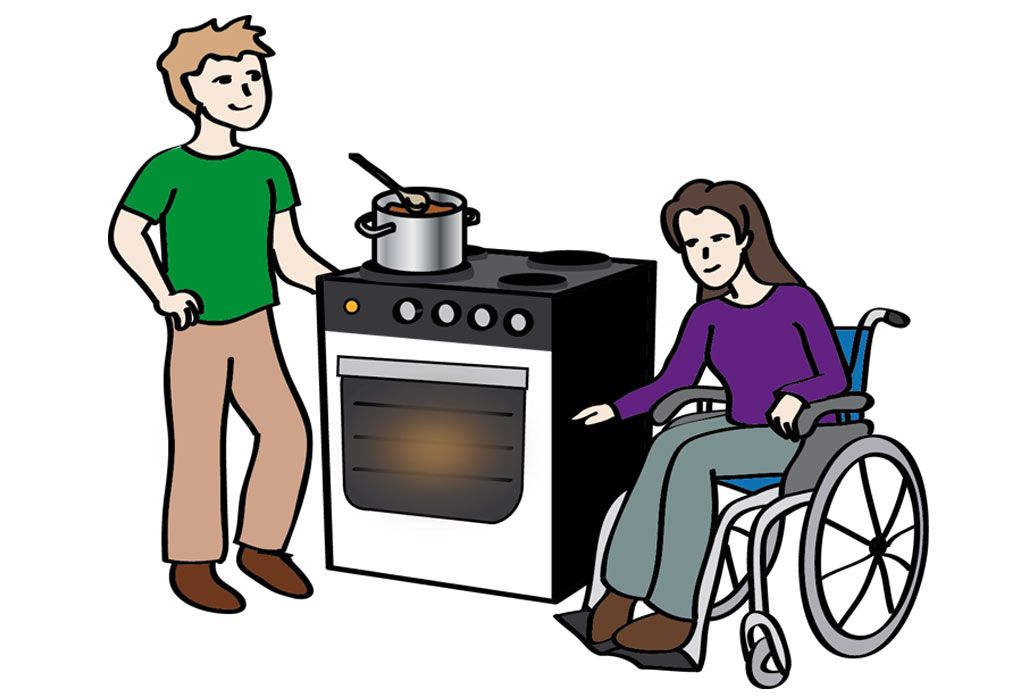 Mann hilft Frau im Rollstuhl beim Kochen