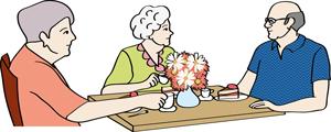 Zwei Senioren und eine Senioren sitzen am Tisch, trinken Kaffee, essen Kuchen und unterhalten sich.