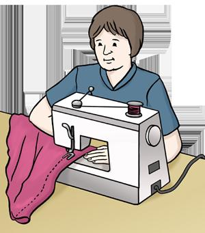 Frau näht an einer Nähmaschine.